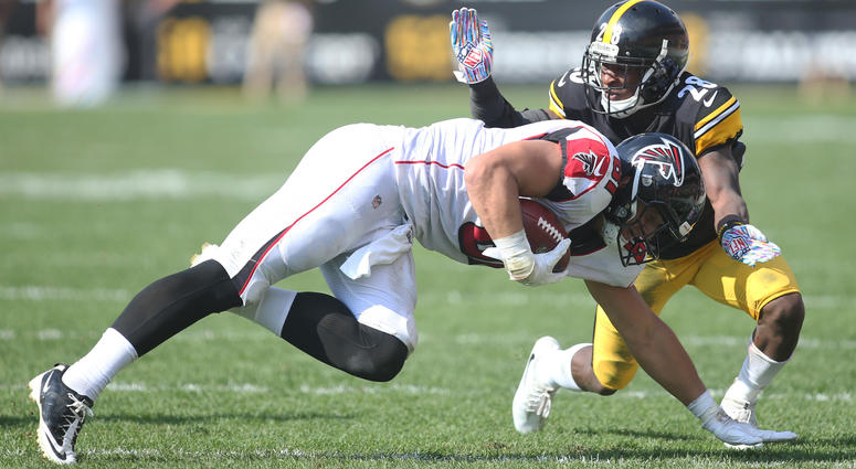 Atlanta Falcons tight end Austin Hooper (81) is tackled after a catch against Pittsburgh Steelers cornerback Mike Hilton (28) during the second quarter at Heinz Field. Pittsburgh won 41-17.