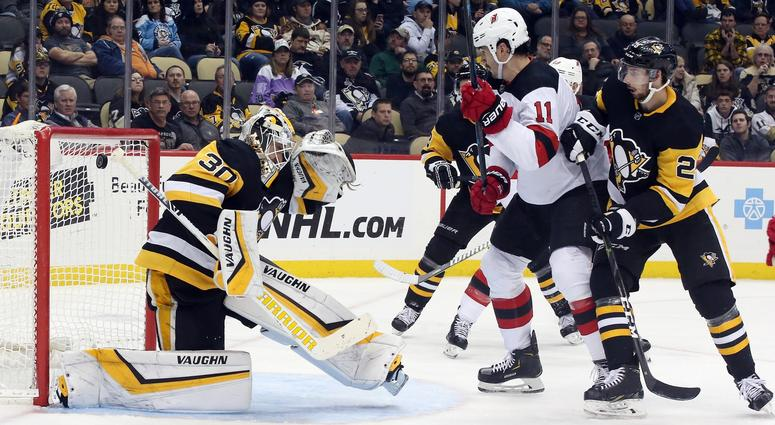 A shot by New Jersey Devils right wing Kyle Palmieri (not pictured) eludes Pittsburgh Penguins goaltender Matt Murray (30) for a goal as Devils center Brian Boyle (11) looks on during the third period