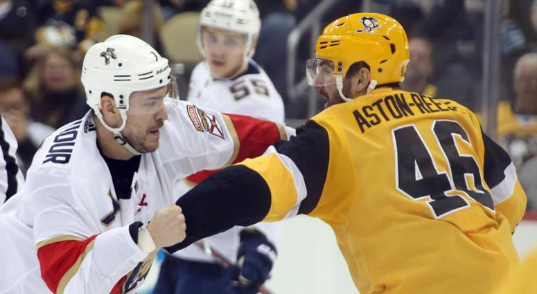 Pittsburgh Penguins center Zach Aston-Reese (46) and Florida Panthers center Colton Sceviour (7) fight during the third period at PPG PAINTS Arena. The Penguins won 5-1.