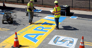 Will Belazoos, left, and Connor Freitas, of Road Safe Traffic Systems, paint the starting line Thursday, April 11, 2019, in Hopkinton, Mass., for the 123rd running of the Boston Marathon. The marathon is scheduled for Monday, April 15.