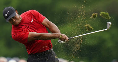 Tiger Woods hits on the 12th hole during the final round for the Masters golf tournament, Sunday, April 14, 2019, in Augusta, Ga.