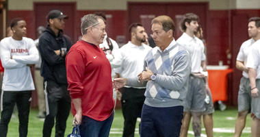 New England Patriots head coach Bill Belichick, left, talks with Alabama football coach Nick Saban at Alabama's NFL Pro Day, Tuesday, March 19, 2019, in Tuscaloosa, Ala