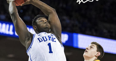 Duke forward Zion Williamson (1) goes up for a dunk against North Dakota State forward Rocky Kreuser (34) during the first half of a first-round game in the NCAA men's college basketball tournament Friday, March 22, 2019, in Columbia, S.C