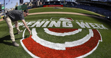 Andy Burnette, of the PNC Ground Crew paints, the Opening Week logo on the field at PNC Park Wednesday, March 27, 2019 in preparation for the Pittsburgh Pirates home-opener on Monday, April 1, against the St. Louis Cardinals