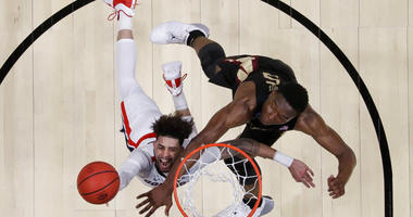 Gonzaga guard Josh Perkins, left, drives to the basket past Florida State forward Mfiondu Kabengele during the first half an NCAA men's college basketball tournament West Region semifinal Thursday, March 28, 2019, in Anaheim, Calif