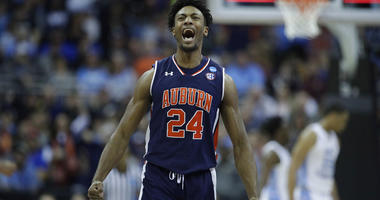 Auburn's Anfernee McLemore celebrates at the end of the first half of a men's NCAA tournament college basketball Midwest Regional semifinal game against North Carolina Friday, March 29, 2019, in Kansas City, Mo.
