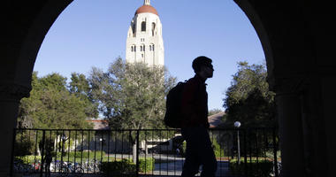 a Stanford University student walks in front of Hoover Tower on the Stanford University