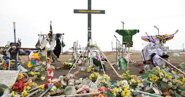 A memorial is displayed for the victims of the Humboldt Broncos junior hockey team bus crash on the corner of highway 35 and highway 335 near Codette, Saskatchewan, Canada, on Saturday, April, 6, 2019. The Broncos' bus collided with a semi driven by a nov