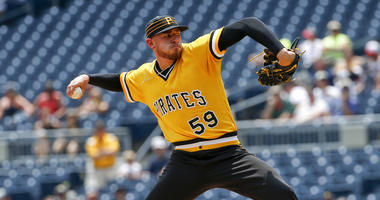 Bell's double in 10th gives Pirates 5-game sweep of Brewers
