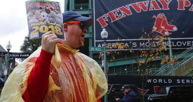 A vendor sells programs outside Fenway Park Game 1 of the World Series