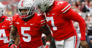 Ohio State running back Mike Weber, left, celebrates his touchdown against Michigan