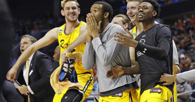 UMBC players celebrate a teammate's basket during the second half against Virginia