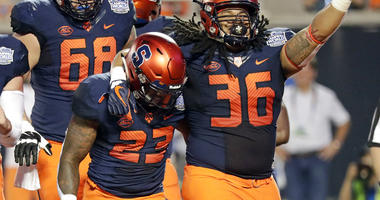 Syracuse fullback Chris Elmore (36) celebrates with running back Abdul Adams (23) after Adams scored a touchdown on a 3-yard run against West Virginia