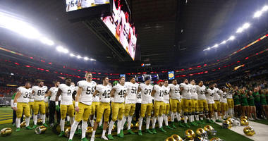 Notre Dame players stand in the end zone singing in the direction of their fans after their 30-3 loss to Clemson in the NCAA Cotton Bowl