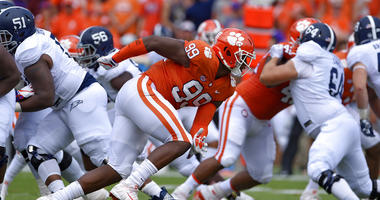Clemson's Clelin Ferrell (99) rushes into the backfield during the first half of the team's NCAA college football game against Georgia Southern in Clemson