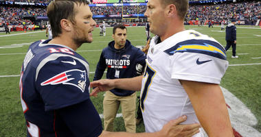New England Patriots quarterback Tom Brady (12) and Los Angeles Chargers quarterback Philip Rivers
