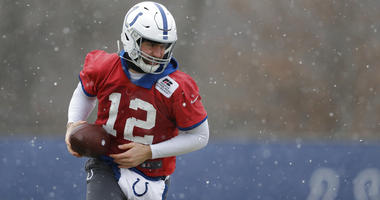 Indianapolis Colts quarterback Andrew Luck runs a drill during practice at the NFL football team's facility