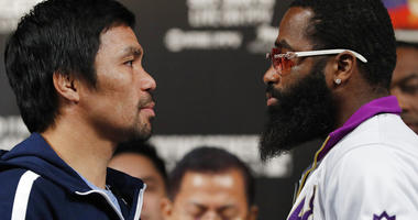 Manny Pacquiao, left, and Adrien Broner pose for photographers during a news conference Wednesday, Jan. 16, 2019, in Las Vegas.