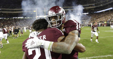 Texas A&M wide receiver Kendrick Rogers, right, celebrates with Charles Oliver (21) after their 74-72 win in seven overtimes against LSU