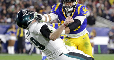 Los Angeles Rams defensive end Aaron Donald hits Philadelphia Eagles quarterback Nick Foles