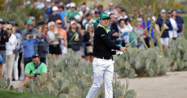 Justin Thomas hits from the second fairway during the third round of the Phoenix Open PGA golf tournament, Saturday, Feb. 2, 2019, in Scottsdale, Ariz