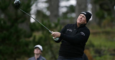 Phil Mickelson follows his drive from the 11th tee of the Spyglass Hill Golf Course during the second round of the AT&T Pebble Beach National Pro-Am golf tournament Friday, Feb. 8, 2019