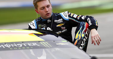 William Byron climbs out of his car after his qualifying run for the Daytona 500 auto race at Daytona International Speedway, Sunday, Feb. 10, 2019, in Daytona Beach, Fla