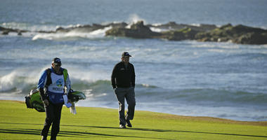 Phil Mickelson walks up the 18th fairway of the Pebble Beach Golf Links with his brother and caddie Tim Mickelson during the final round of the AT&T Pebble Beach Pro-Am golf tournament Monday, Feb. 11, 2019, in Pebble Beach, Calif.