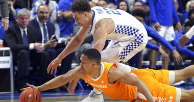 Kentucky's Reid Travis, top, and Tennessee's Grant Williams chase down a loose ball during the first half of an NCAA college basketball game in Lexington, Ky., Saturday, Feb. 16, 2019