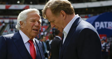NFL Commissioner Roger Goodell, right, talks with New England Patriots owner Robert Kraft