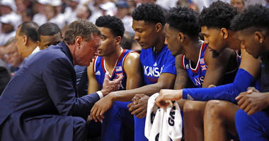 Kansas coach Bill Self talks to his players on the bench