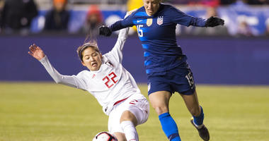 United States' Megan Rapinoe, right, tries to get around Japan's Risa Shimizu, left, with the ball during the first half of SheBelieves Cup soccer match, Wednesday, Feb. 27, 2019, in Chester, Pa