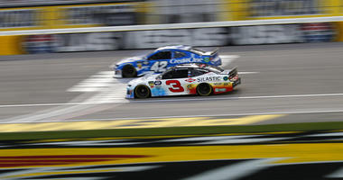 Austin Dillon (3) and Kyle Larson (42) drive during qualifying for a NASCAR Cup Series auto race at the Las Vegas Motor Speedway, Friday, March 1, 2019, in Las Vegas