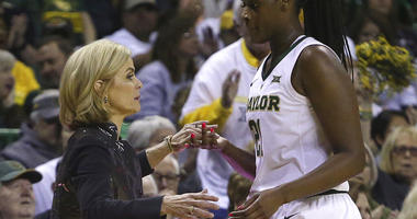 Baylor head coach Kim Mulkey thanks Baylor center Kalani Brown (21) as she head to the bench in the second half of an NCAA college basketball game, Saturday, March 2, 2019, in Waco, Texas. Baylor defeated Oklahoma State 76-44