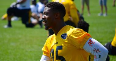 Steelers CB Artie Burns stretches during the team's OTA