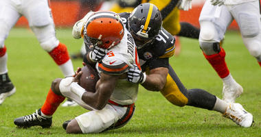 Pittsburgh Steelers defensive tackle Cameron Heyward (97) sacks Cleveland Browns quarterback Tyrod Taylor (5) during the fourth quarter at FirstEnergy Stadium.