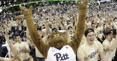 The Pittsburgh Panthers mascot and student section cheer after scoring against the Virginia Tech Hokies during the first half at the Petersen Events Center.