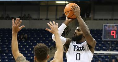 Pittsburgh Panthers guard Jared Wilson-Frame (0) shoots against Wake Forest Demon Deacons guard Mitchell Wilbekin (10) during the first half at the Petersen Events Center.