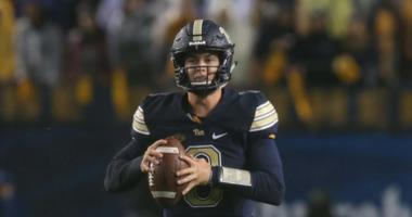 Pittsburgh Panthers quarterback Kenny Pickett (8) scrambles with the ball against the Penn State Nittany Lions during the first quarter at Heinz Field.