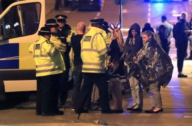 Police at Manchester Arena after reports of an explosion at the venue during an Ariana Grande concert.