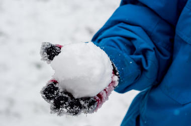 Snow ball held in hand during fight