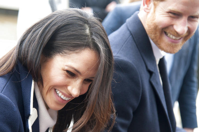 FILE - In this file photo dated Thursday March 8, 2018, Britain's Prince Harry and his fiancee Meghan Markle arrive for an event for young women.