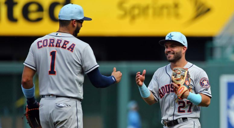 Correa, Astros top Royals 7-4