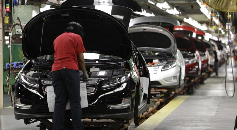assembly worker Julaynne Trusel works on a Chevrolet Volt at the General Motors Hamtramck Assembly plant in Hamtramck, Mich.