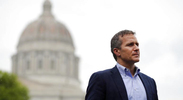 In this May 17, 2018, photo, Missouri Gov. Eric Greitens stands off to the side before stepping up to the podium to deliver remarks near the capitol announcing the release of funds for the state's biodiesel program in Jefferson City.
