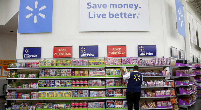 FILE- In this Nov. 9, 2017, file photo, a Walmart employee scans items while conducting an exercise during a Walmart Academy class session at the store in North Bergen, N.J.
