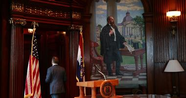 Missouri Gov. Eric Greitens leaves the podium after announcing his resignation in the governor's office, Tuesday, May 29, 2018, in Jefferson City, Mo.