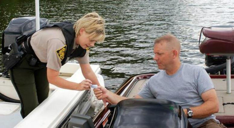 An officer tests a boater during Operation Dry Water 2017