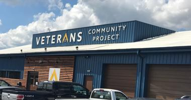 Cars sit outside the headquarters of the Veterans Community Project in Kansas City