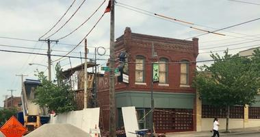 A gaping peice of the side of the old Mardi Gras Club near 19th and Vine is missing after a partial building collapse. The scaffolding is bowed out from the pressure of the bricks